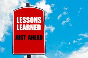 Lessons Learned Just Ahead  motivational quote written on red road sign isolated over clear blue sky background. Concept  image with available copy space