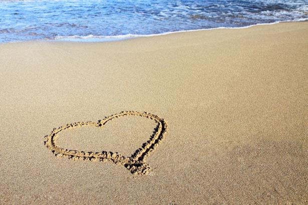 Sand heart and ocean