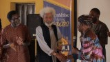 Prof. Wole Soyinka receiving an award from Tunde Kelani (2)