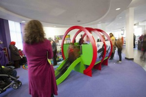 """"""" Our Big Lottery funded Junction 3 library opened in March with a Reading Tunnel and Slide in the children's library. It has caused a stir – it is fair to say, with both staff and the public but how lovely to have the space to cause a stir!"""" Bristol - Sent in by Kate Murray, Head of Libraries"""