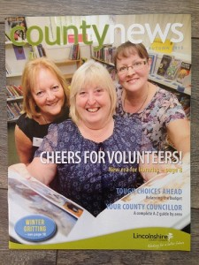 "Lincolnshire - ""Cheers for Volunteers"".  Council brochure celebrates volunteers replacing paid library staff."