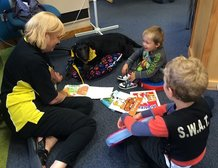"""""""The boys love coming down to the library and reading with Gracie, she is so patient with them and they talk to her as if she were human! They love the library and reading but it's a special treat when Gracie is here!"""" says the Mum of these two kids"""