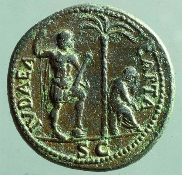 A coin commemorating the conquest of Judea, depicting a roman soldier and a captive woman.