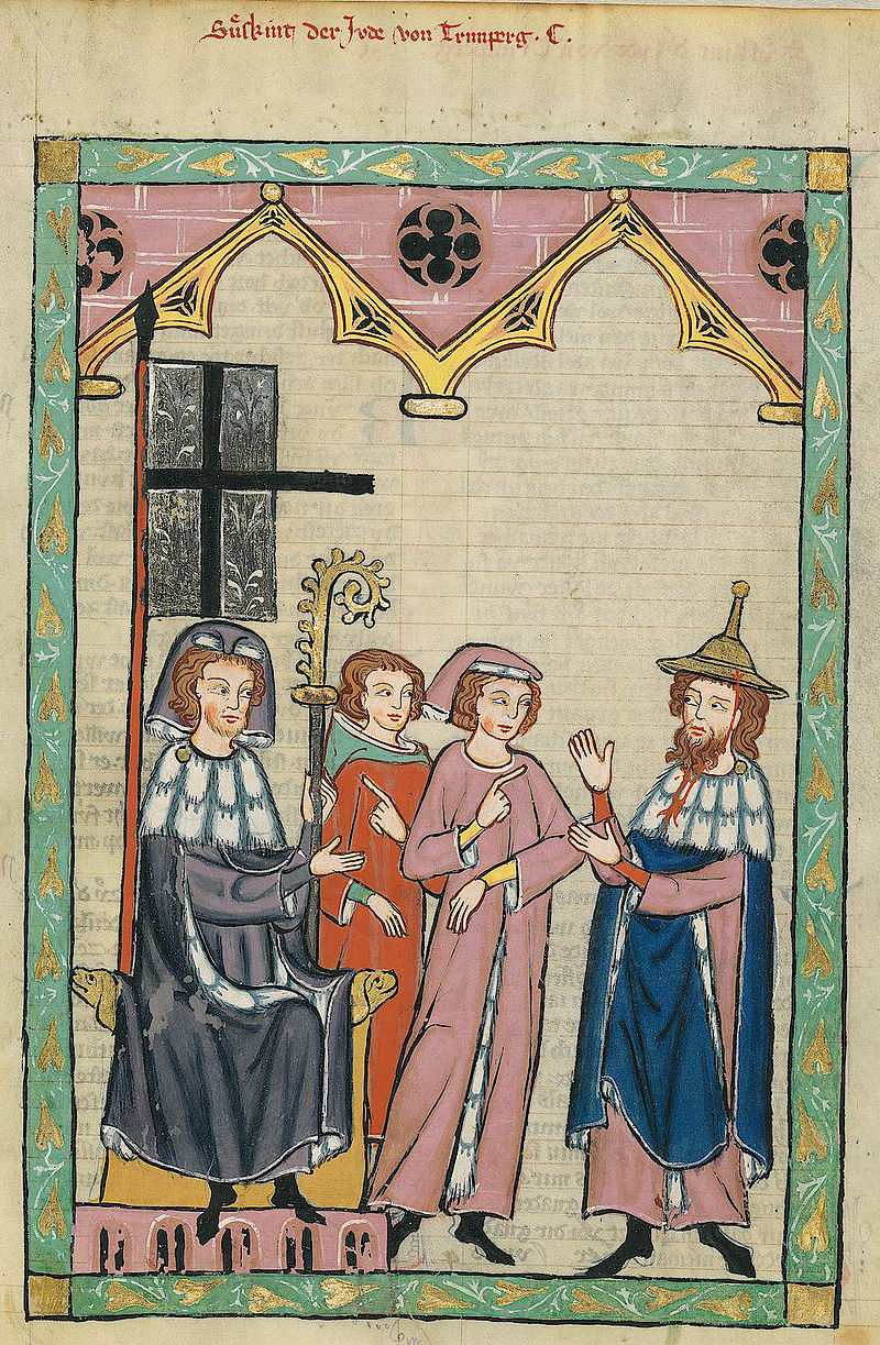 "Jewish poet Süßkind von Trimberg (right) wearing a typical ""Jewish hat"" in the Codex Manesse from 14th century Germany. These hats were originally worn by Jewish men by choice, but in many Northern European countries beginning in the 12th century, became part of the mandatory garb for Jews."