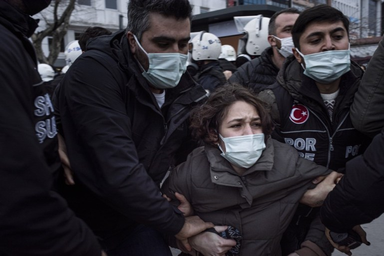 Members of the Turkish Police detain a protester at a protest organized by students from Boğaziçi University on February 2 in Istanbul.  - Alba Cambeiro