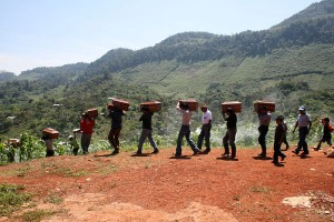 Indigenous Mayans carrying their loved one's remains after an exhumation in the Ixil Triangle, Guatamala. The Ixil people have been the victims of genocide during Guatamala's civil war © Trocaire / CAFCA archive | Flickr
