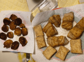 Hush Puppies on a plate with paper towels underneath