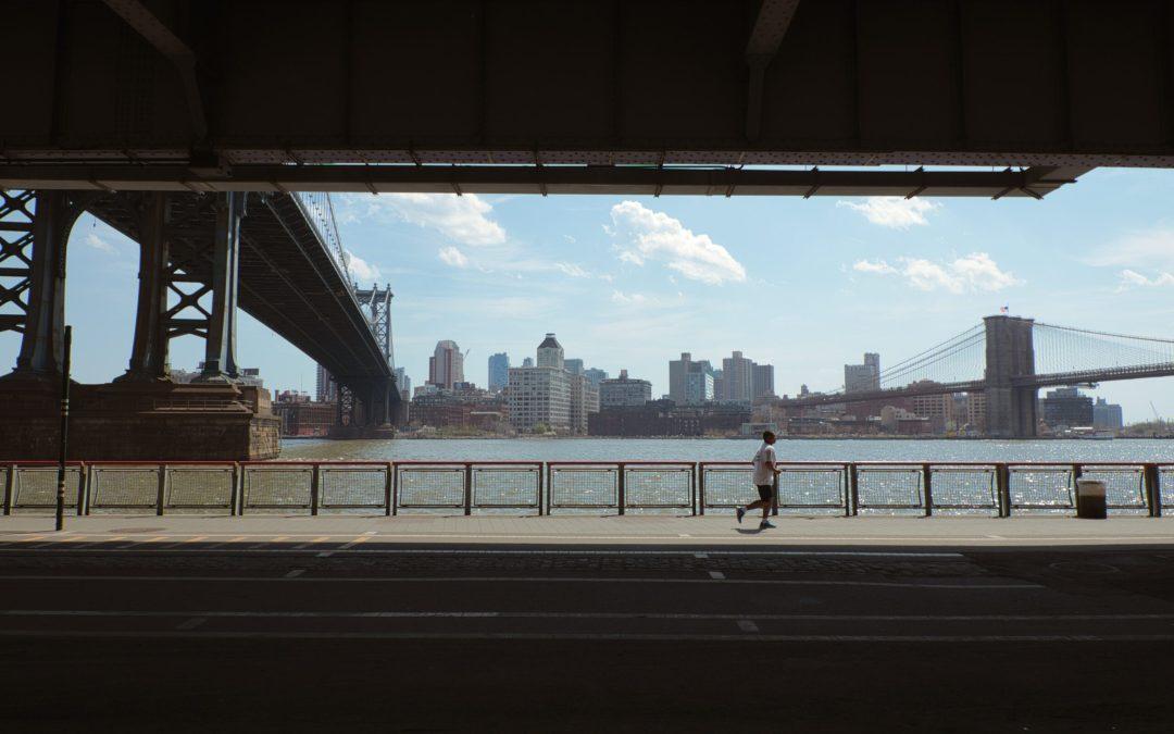 A runner under an overpass