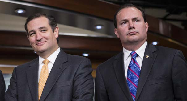 Sen. Ted Cruz, R-Texas, left, and Sen. Mike Lee, R-Utah, during a news conference with conservative Congressional Republicans at the Capitol in Washington, Thursday, Sept. 19, 2013.  Cruz and Lee stand as the Senate's dynamic duo for conservatives, crusading against President Barack Obama's health care law while infuriating many congressional Republicans with a tactic they consider futile, self-serving and detrimental to the party's political hopes in 2014. (AP Photo/J. Scott Applewhite)