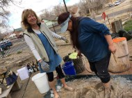 Janet and Maya stomping clay for the oven.