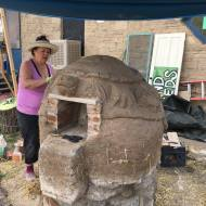 Maya sculpting the design.
