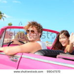 stock-photo-couple-happy-in-vintage-retro-convertible-car-friends-driving-on-summer-road-trip-in-pink-car-99047570