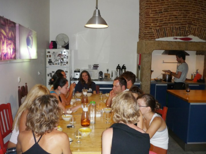 Breaking bread at the Lisbon Lounge Hostel (source – Pulped Travel)