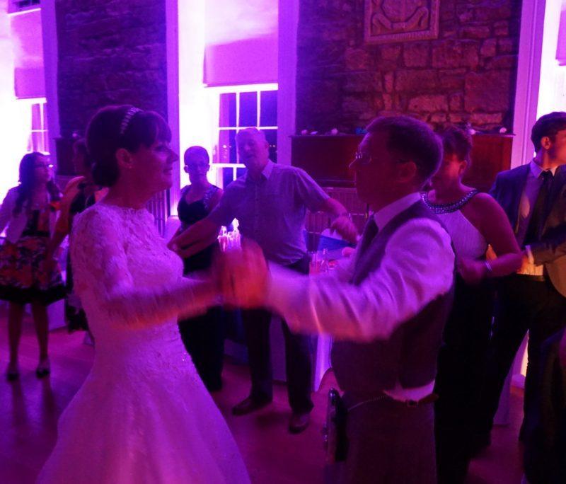 People dancing on busy dance floor