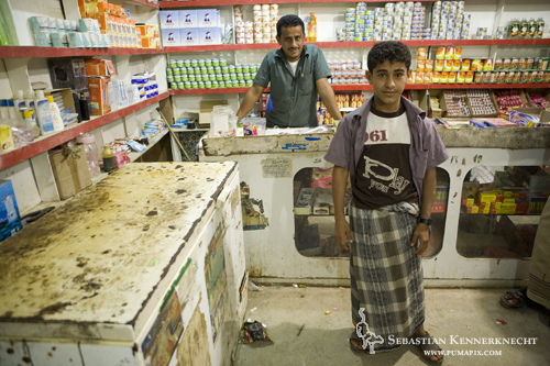 Grocery store and owners, Hawf Protected Area, Yemen