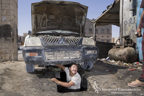 Mechanic under car, Yemen
