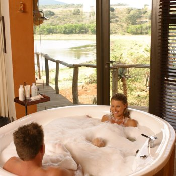 Pumba Private Game Reserve Weddings Wedding Couple Having a Relaxing Bath