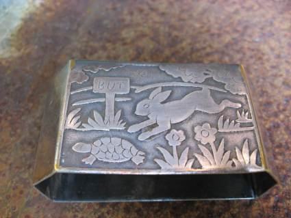 Tortoise and hare silver napkin ring_G_PumpjackPiddlewick