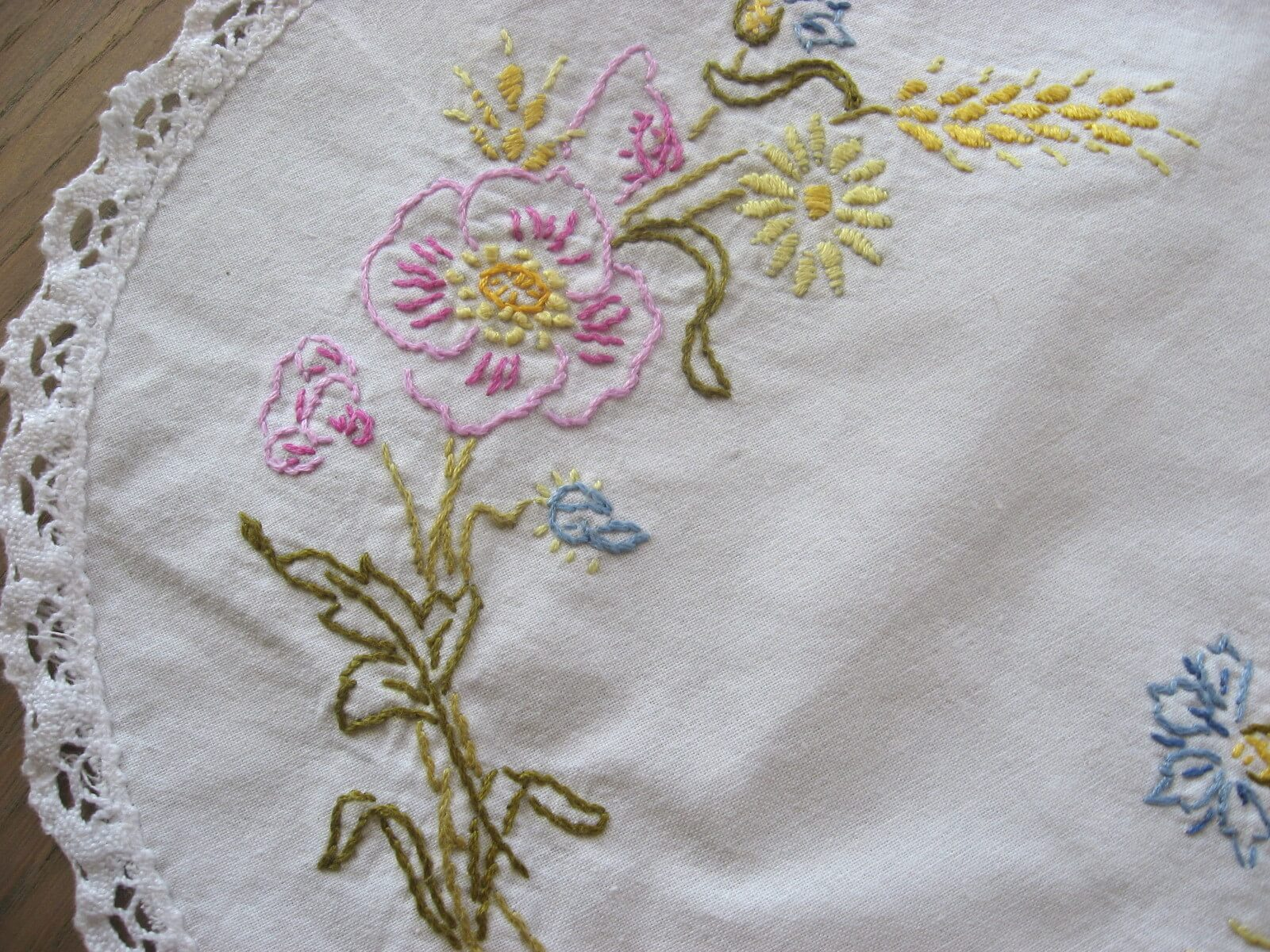 hand embroidered round linen doily at PumpjackPiddlewick