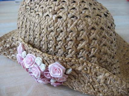 straw hat with pink roses at PumpjackPiddlewic