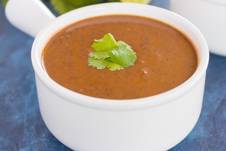 This Easy Black Bean Soup is zesty, filling, and ready in just 30 minutes. Loaded with black beans, spices, and lots of flavor, this simple soup serves as a hearty main dish and is perfect for a meatless entree!