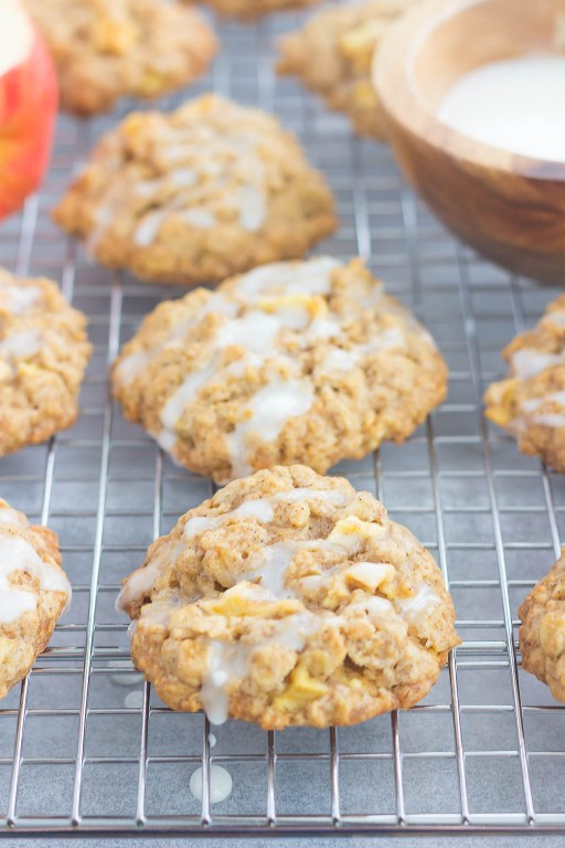 These Glazed Apple Oatmeal Cookies are soft, chewy and loaded with flavor. Packed with chunks of apples, fall spices and topped with a deliciously sweet glaze, you'll be making this easy cookie all season long! #oatmealcookies #applecookies #appleoatmealcookies #applerecipe #cookies #fallcookie #fallrecipe #applerecipe #falldessert #appledessert