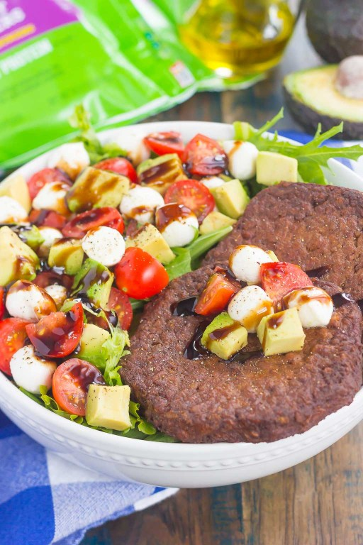 This Avocado Caprese Burger Salad is a healthier way to switch up your mealroutine. It's packed with diced avocado, cherry tomatoes, mozzarella pearls,veggie burgers and drizzled with a sweet balsamic glaze. Simple to make and perfect for just about any time,you'll love the delicious taste of this flavorfulsalad!
