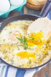 Baked Eggs with Rosemary and Thyme make a simple breakfast that's loaded with flavor. Fresh herbs and a sprinkling of cheese give this dish a savory blend that's perfect for a cozy dish. Serve with a side of crusty bread and this will quickly become a new favorite!