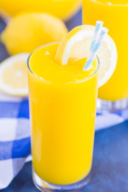 Frozen Mango Lemonade is a delicious way to beat the summer heat. With just four ingredients and ready in less than 5 minutes, you'll love the cool and creamy flavor of sweet mango and tart lemons! #lemonade #frozenlemonade #mangolemonade