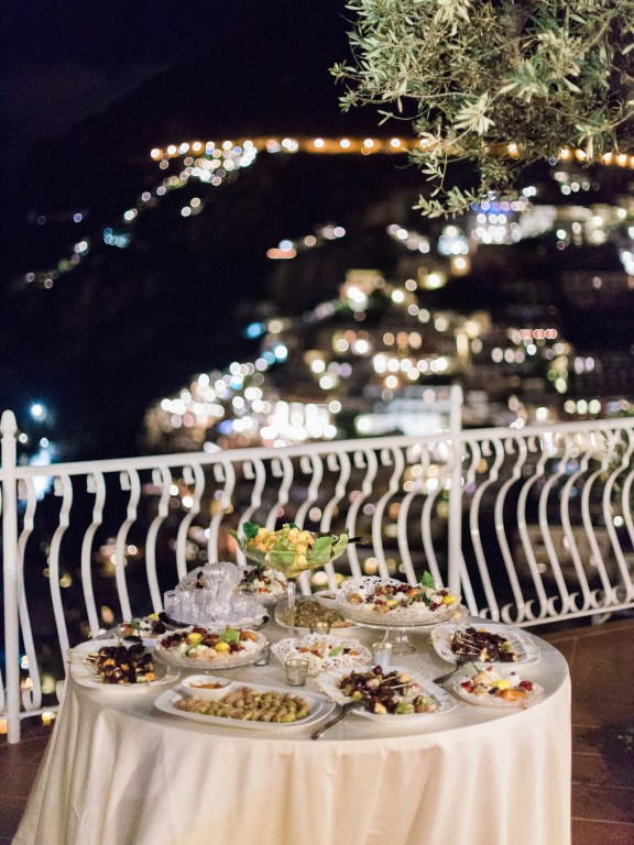 Wedding's dessert with the evening lights of Positano