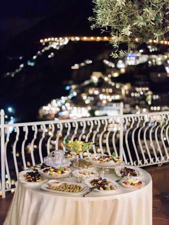 Wedding's dessert with the evening lights of Positano