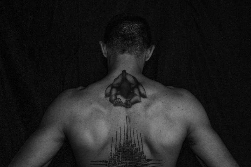 Coach Eric Sandsak with a Gao Yord, a  9 spires Tatto which is a geometric design that represents the 9 sacred peaks of  Mt.  Meru and also contains symbolism of the Buddha with the 3 ovals one above another.