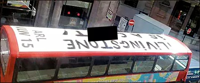 Double-decker bus driven around London with guerilla graffiti