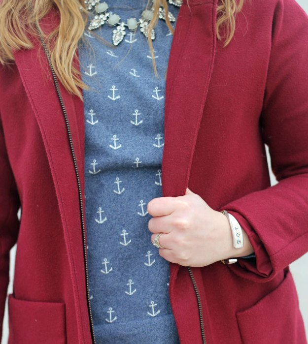 blue-anchor-sweater-black-jeans-maroon-jacket
