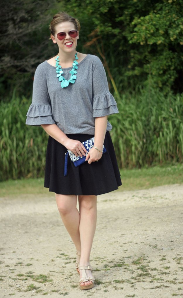 Grey Bell Sleeves: get ready for cooler weather with bell sleeves. Grey bell sleeve top, black swing skirt, BaubleBar seaglass bib necklace in turquoise | Puppies & Pretties
