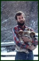 CHRIS WITH PUPPIES .jpg