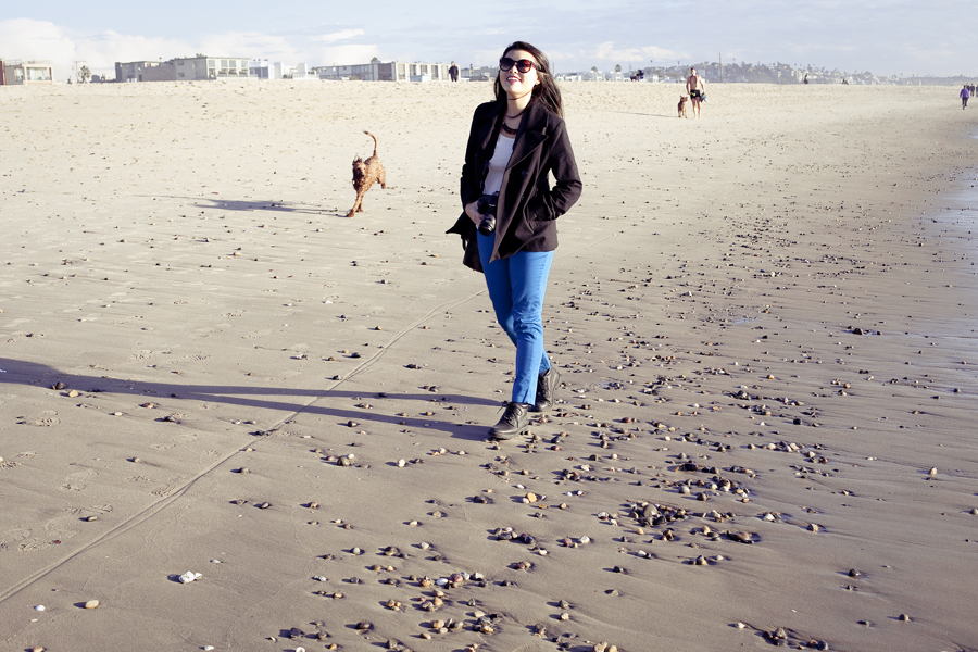 Deb walking along the seashore of Marina Del Rey beach.