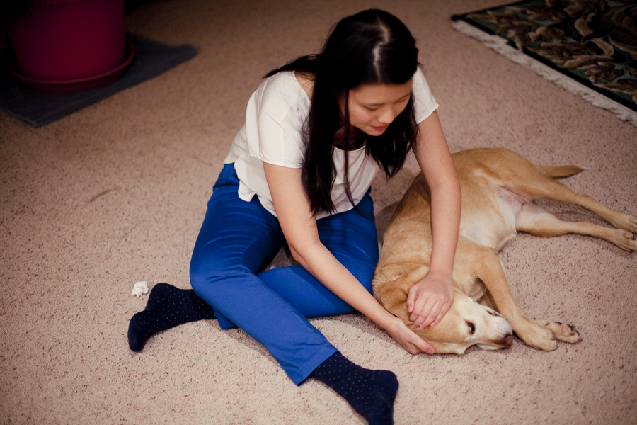 Deb playing with Annabel the dog on the carpet.