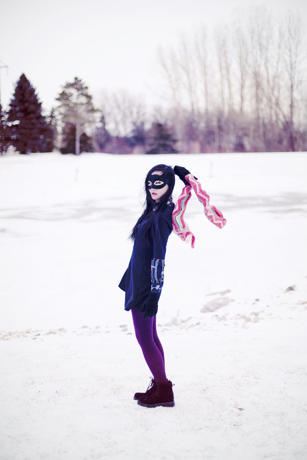 Photoshoot in the snow. Outfit details: Forever21 black pleated dress, Dollhouse grey jacket, Hue maroon red ribbed tights, Fox striped zigzag scarf, thrifted vintage floral black shirt, Fila black men's shoes.