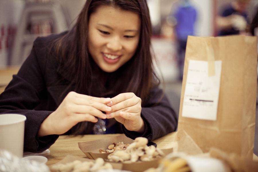 Deb peeling peanuts at Five Guys in Los Angeles.