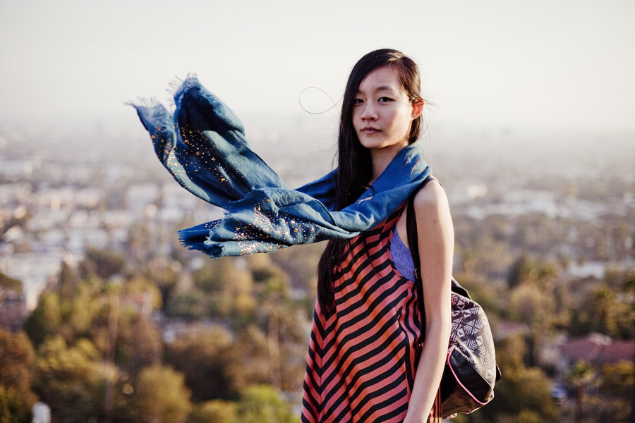 Ren at Runyon Canyon Park in Hollywood, Los Angeles. Outfit details: Uniqlo blue patterned bra-top camisole, Forever21 striped satin orange and black dress, gold studded blue scarf, Forever21 knee-high light grey socks, Fila black men's boots, T-shirt & Jeans geometric tribal printed backpack.