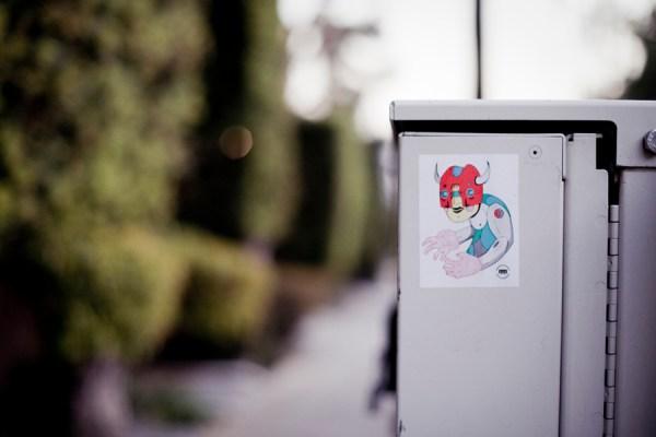 Sticker graffiti on an electrical box.