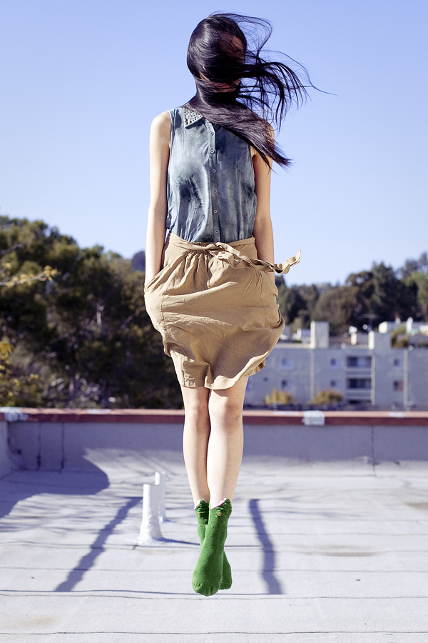 Rooftop photoshoot. Wearing Urban Outfitters dyed sleeveless top with studded collar, Zara brown front-tie skirt with pockets, green crocodile socks, Top Shoes brown zippered boots.