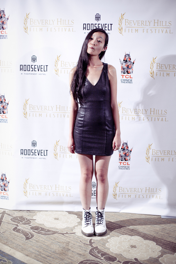 Ren being goofy in front of the backdrop at the Beverly Hills Film Festival awards ceremony at the Four Seasons Hotel.