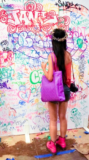 Ren drawing on the graffiti wall at the Lookbook x Rebecca Minkoff Denim Launch Party at the Confederacy Boutique in Hollywood, Los Angeles.