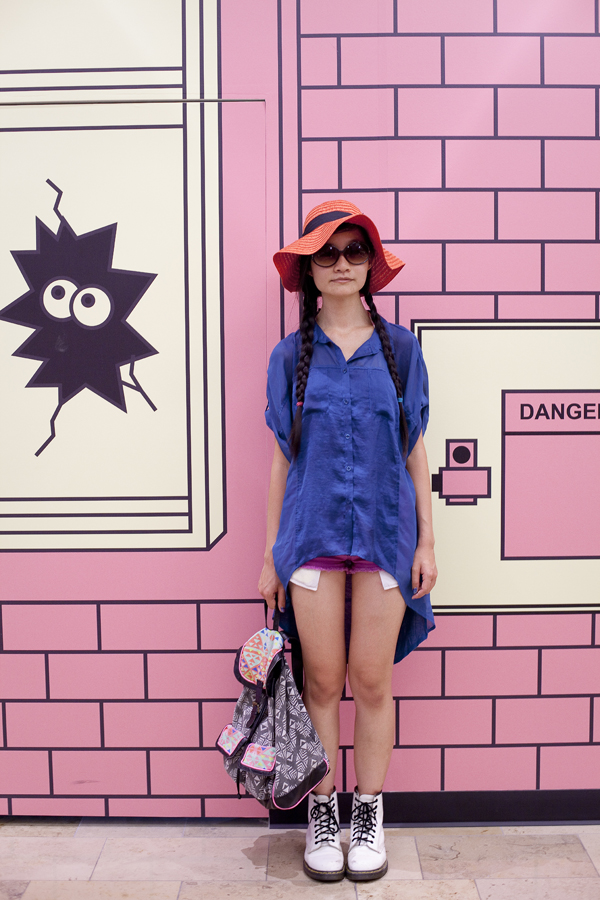 Outfit of the day for day 2 in Las Vegas: Forever 21 magenta denim shorts and red floppy hat, T-shirt & Jeans geometric bag, Cotton On hi-low blue shirt, Dr. Martens classic white boots.