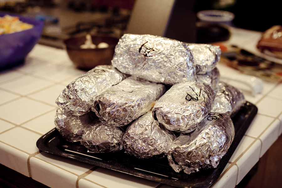 A dozen Chipotle burritos at the REMAP party at Jeff's house.