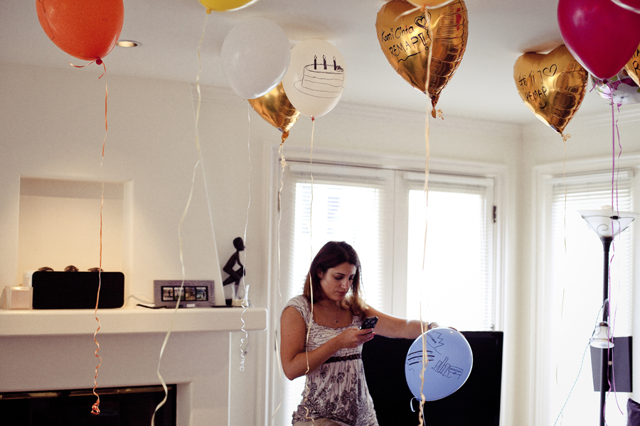 Marta taking a picture of the helium balloons at the REMAP party at Jeff's house.