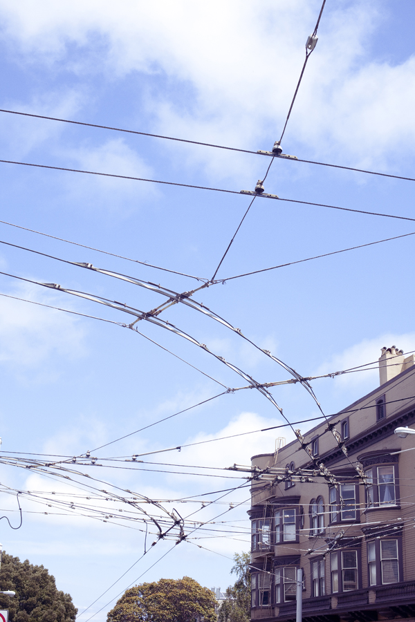 View of electric cable lines for buses on Haight in San Francisco.