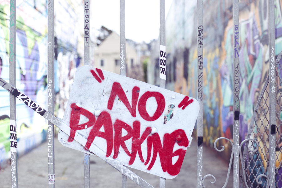 No Parking sign in front of murals on Haight in San Francisco.